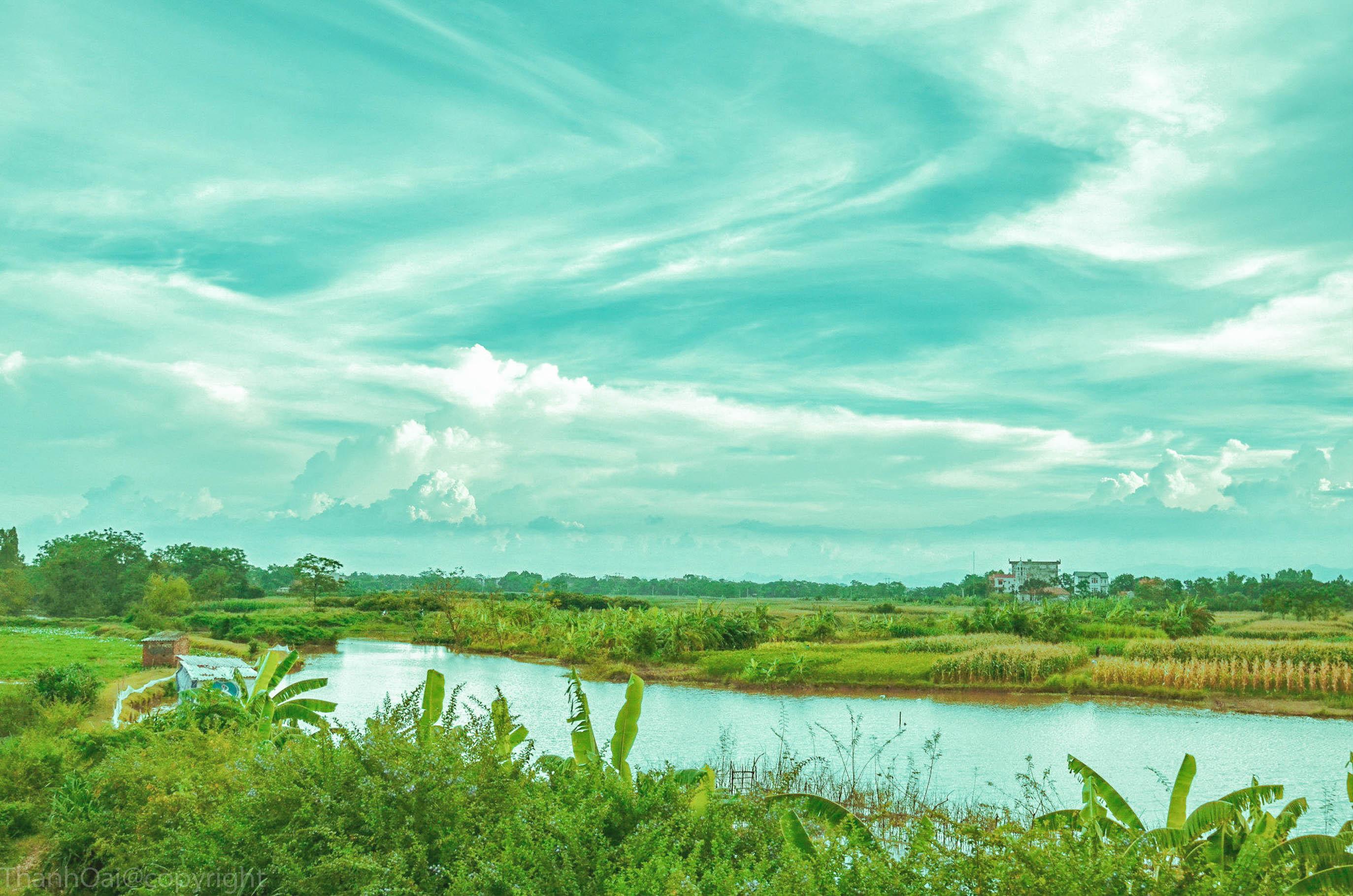 Hình ảnh quê hương con sông uốn quanh