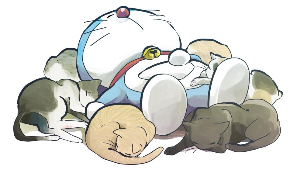 Hình ảnh chú mèo máy Doraemon ngủ cùng với một đống mèo khác