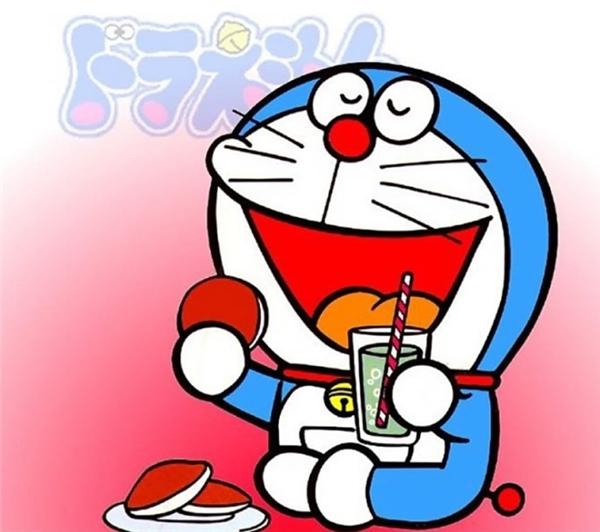 Hình ảnh Doraemon ăn bánh uống nước ngọt