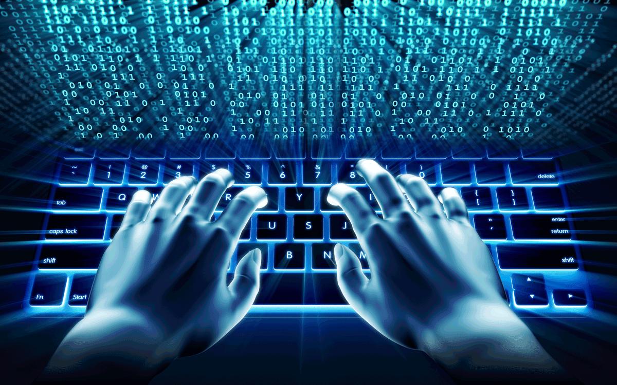 HÌnh ảnh Hacker gõ bàn phím tỏa sáng